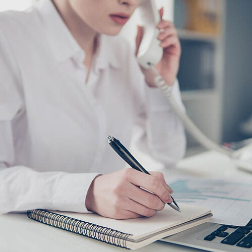 Cropped close up photo beautiful she her business lady pen pencil make notes notepad organizer listen important talk boss chief instruction notebook table bright office wear formal-wear white shirt.